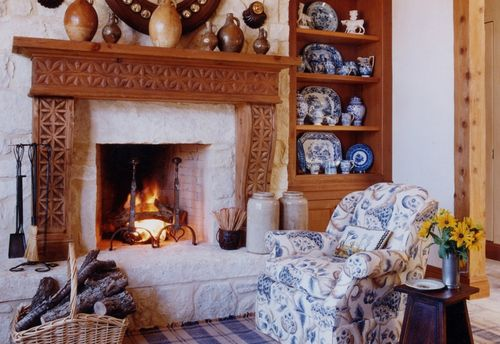 Bunny Williams blue & white china with fireplace