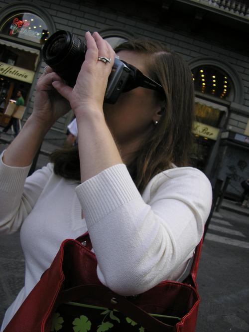 women aiming camera
